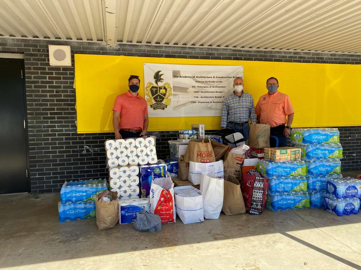 GHBA members Greg Madrey and Jeremy Linzer with Builders Post Tension, and Denny Patterson with Lone Star Air, putting in work to distribute necessary items for Jones Futures Academy.