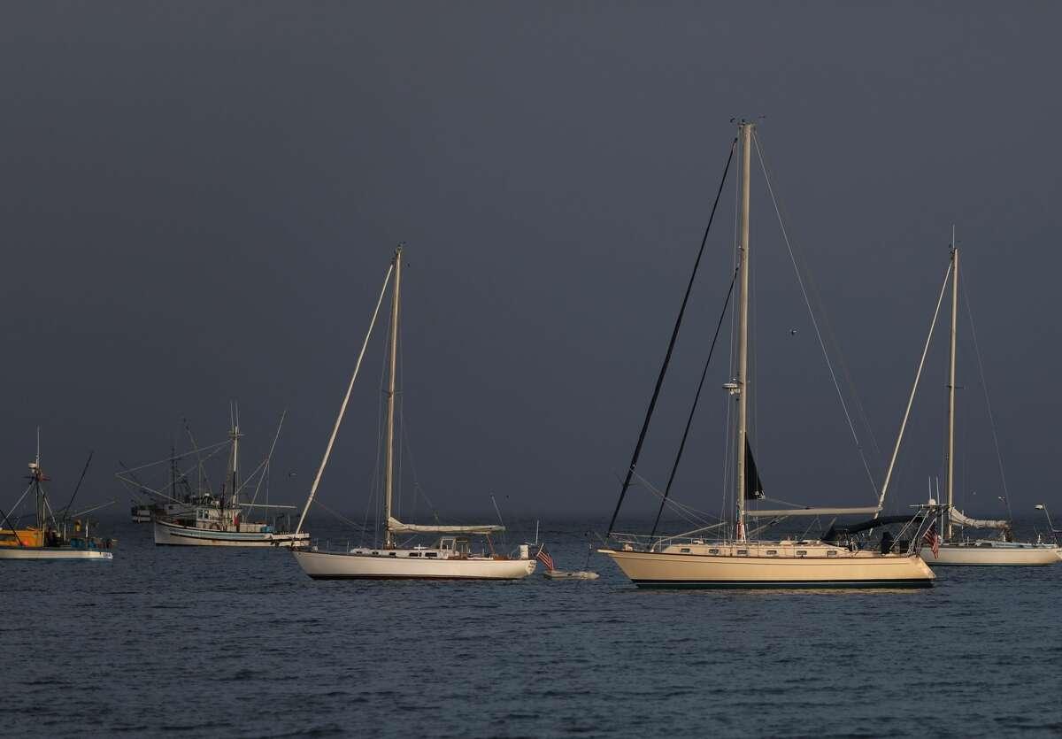 Sailboats are anchored off Main Beach on Friday, May 8, 2020, in Santa Cruz, CA.