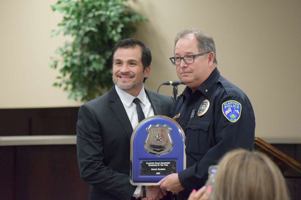 Captain Manuel Balderas was recognized as Supervisor of the Year. He stands with Police Chief Derrick Watson.