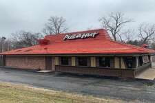 This file photo shows the Pizza Hut in Godfrey that was closed in September along with several other Riverbend Pizza Hut restaurants. On Wednesday, the Flynn Restaurant Group announced it had acquired Pizza Hut restaurants in Alton, Granite City and Collinsville.