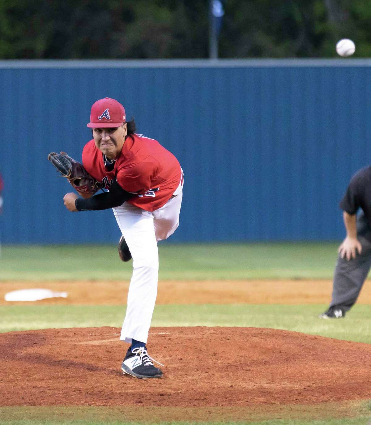 Atascocita pitcher Joey Burgess (21) throws the ball during the second inning of a District 21-6A baseball game against Kingwood at Kingwood High School, Tuesday, March 24, 2021, in Kingwood.