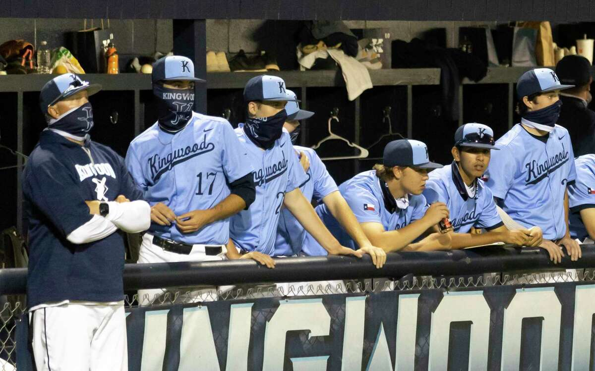 Kingwood head coach Kelly Mead and his players watch a play during the sixth inning of a District 21-6A baseball game against Atascocita at Kingwood High School, Tuesday, March 24, 2021, in Kingwood.