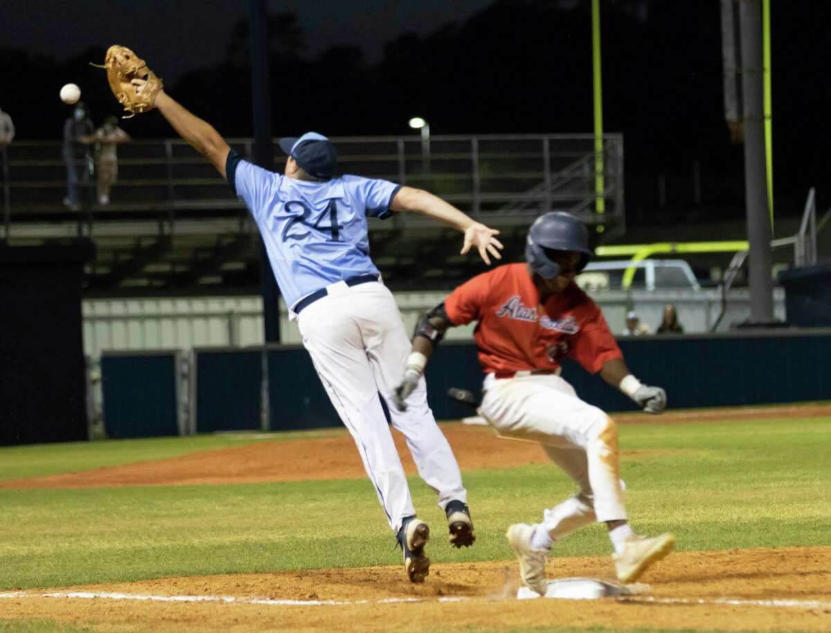 Kingwood shortstop Austin Shever (24) jumps to catch a toss before Kendall George #20 of Atascocita reaches second base during the fourth inning of a District 21-6A baseball game at Kingwood High School, Tuesday, March 24, 2021, in Kingwood.