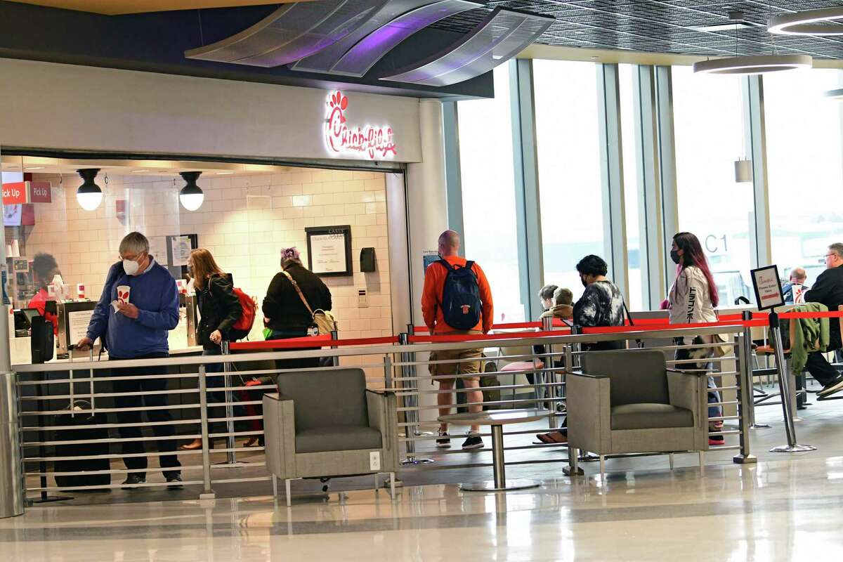 Passengers wait in line at Chick-fil-A at the Albany International Airport on Wednesday, March 24, 2021 in Colonie, N.Y. . (Lori Van Buren/Times Union)