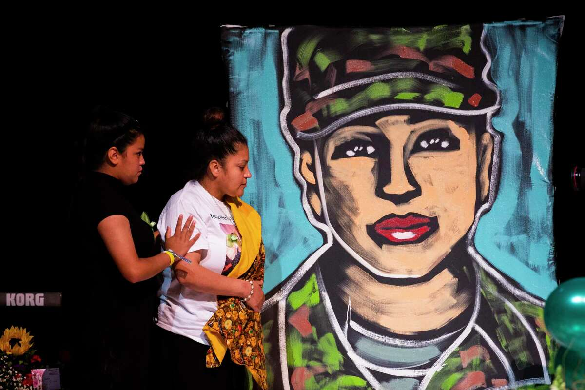 Gloria Guillén, the mother of U.S. Army Specialist Vanessa Guillén, and Lupe Guillén approach a painting created by speed painter Ange Hillz, at Cesar Chavez High School on Friday, Aug. 14, 2020, in Houston.
