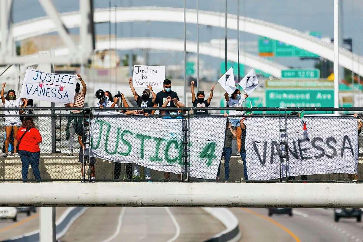 Demonstrators hold signs asking for justice for slain Fort Hood soldier Vanessa Guillén, Wednesday, July 22, 2020, on the Dunlavy Street bridge over Interstate 59 in Houston.