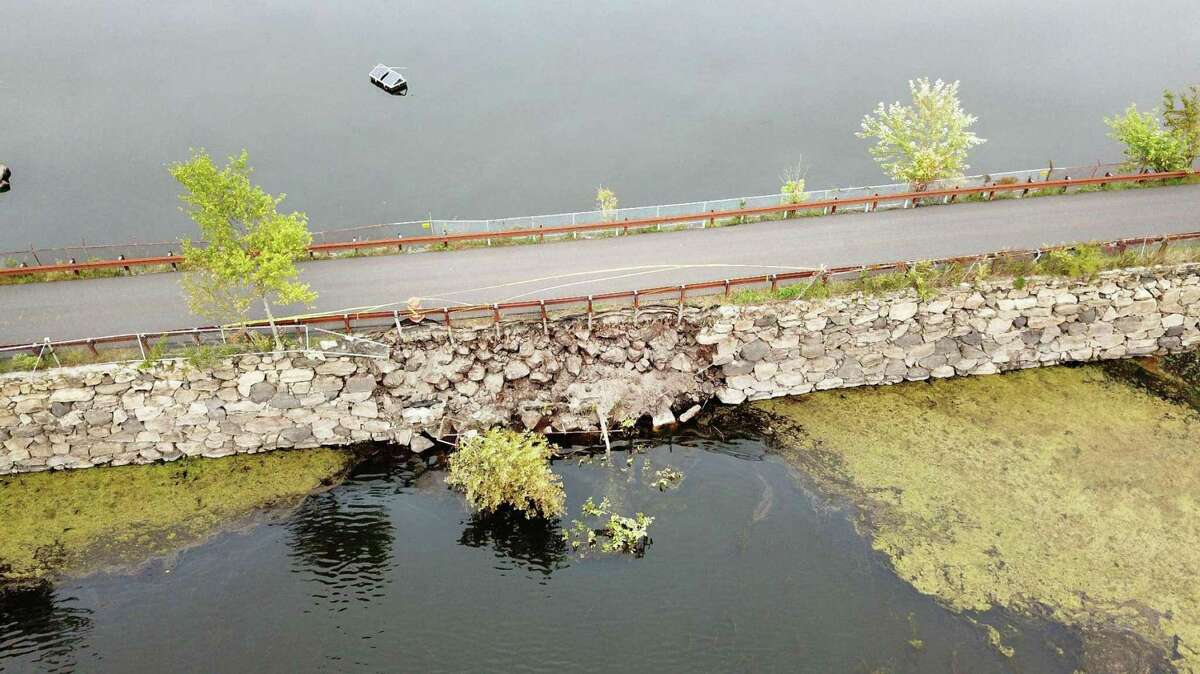 The embankment that runs across Rockwood Reservoir in backcountry Greenwich partially collapsed, forcing the roadway to close in September 2020. Repairs are underway this spring.