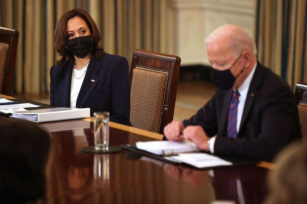 Vice President Kamala Harris and President Biden meet with Cabinet members and immigration advisers at the White House on Wednesday.