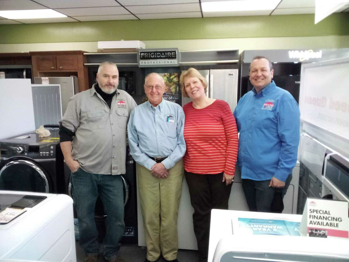 Dick Cooper TV & Appliance Repair is saying farewell to Ray Aeschliman, second from left, who is retiring this week. He is joined by service manager Jim Ferrentino, left, and owners Sherry (Cooper) Percivalle and Rich Cooper.
