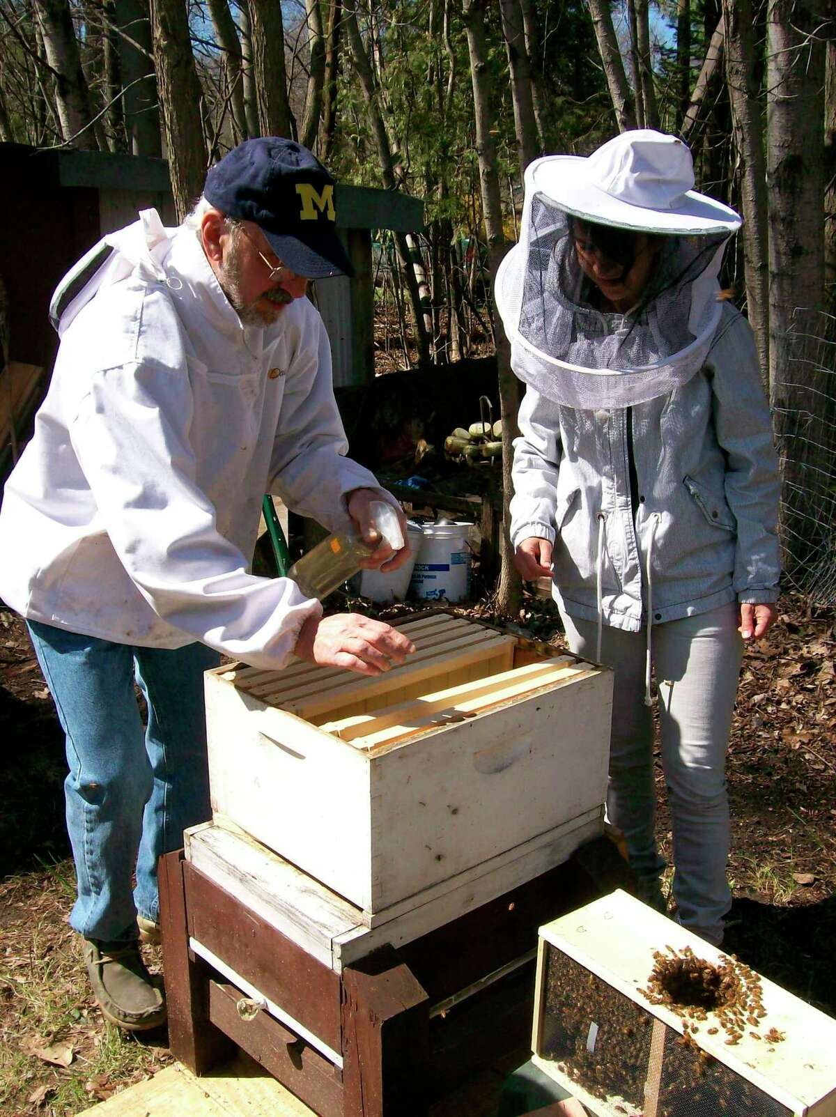 Members of theScottville Beekeepers of Mason County install bees in spring. The groupwill host an informative workshop this weekend. (Courtesy Photo)