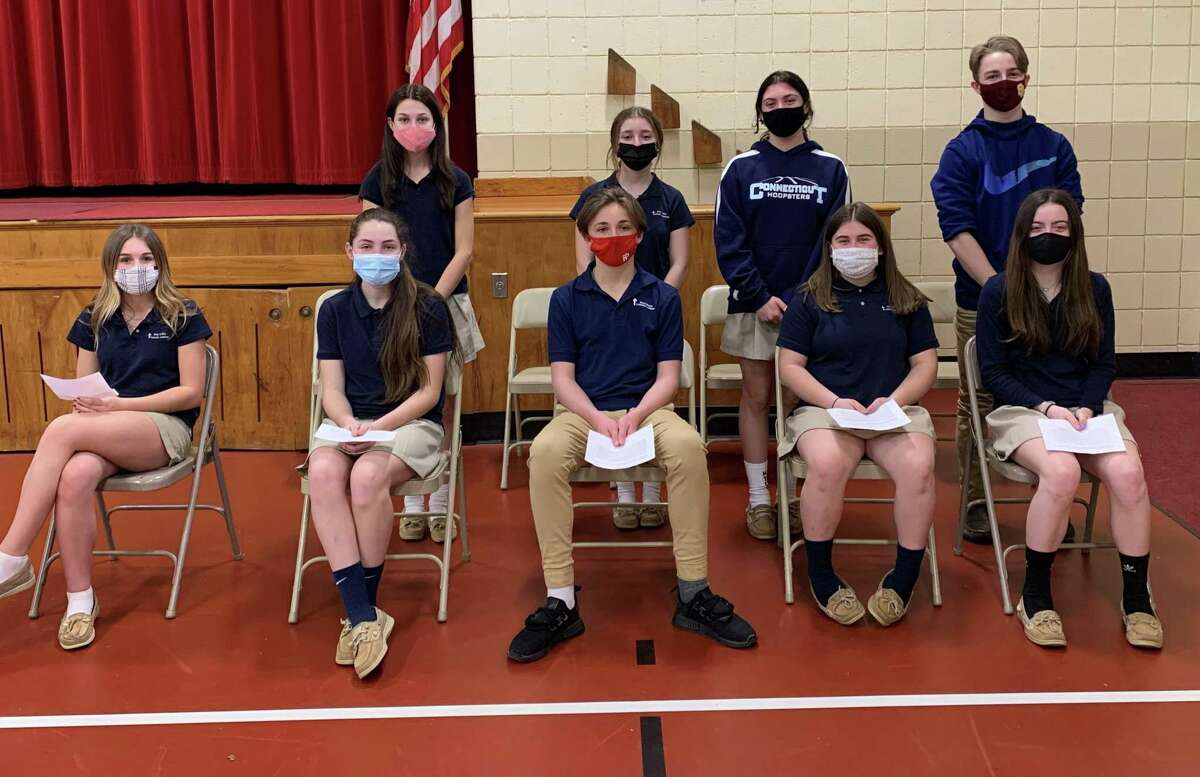 The Holy Trinity Catholic Academy recently honored those students inducted into the school's Chapter of the National Junior Honor Society. Pictured are, back, left to right, present NJHS members Gabriella Pereira, Briana Chiaro, Angelina McKenna, Connor Fahey, front, Ella Dunford, Sara Parker, Jeremy Benton, Amanda Gardecki and Isabella Gracia.