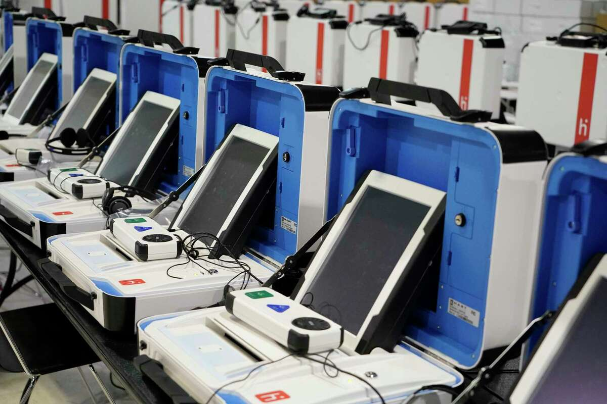 New voting machine are shown at the Harris County Election Technology Center, 11525 Todd St., Wednesday, March 24, 2021 in Houston. A ballot is printed and inserted into the separate machine, that counts the ballot and then deposits it in the ballot box.