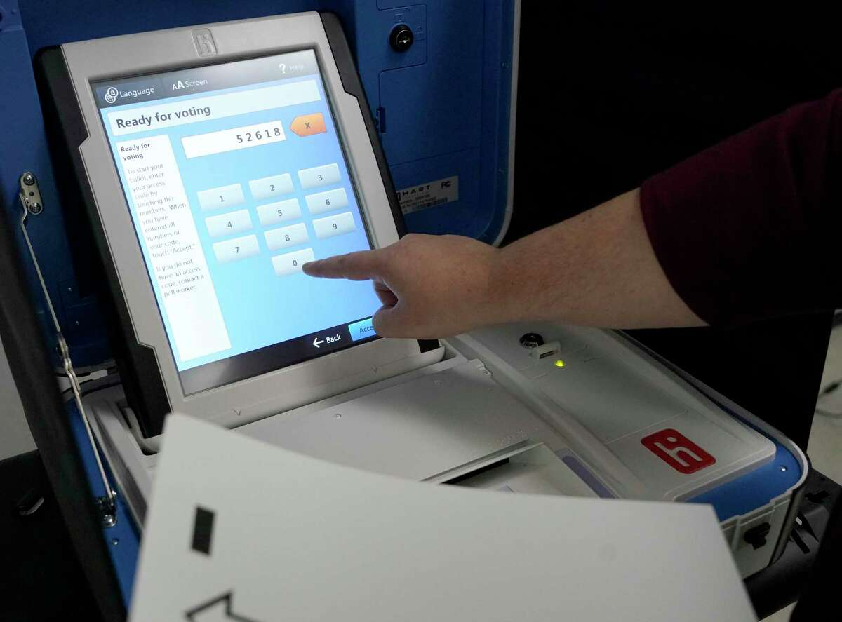 Roxanne Werner, deputy director of communication, demonstrates a new voting machine at the Harris County Election Technology Center, 11525 Todd St., Wednesday, March 24, 2021 in Houston.