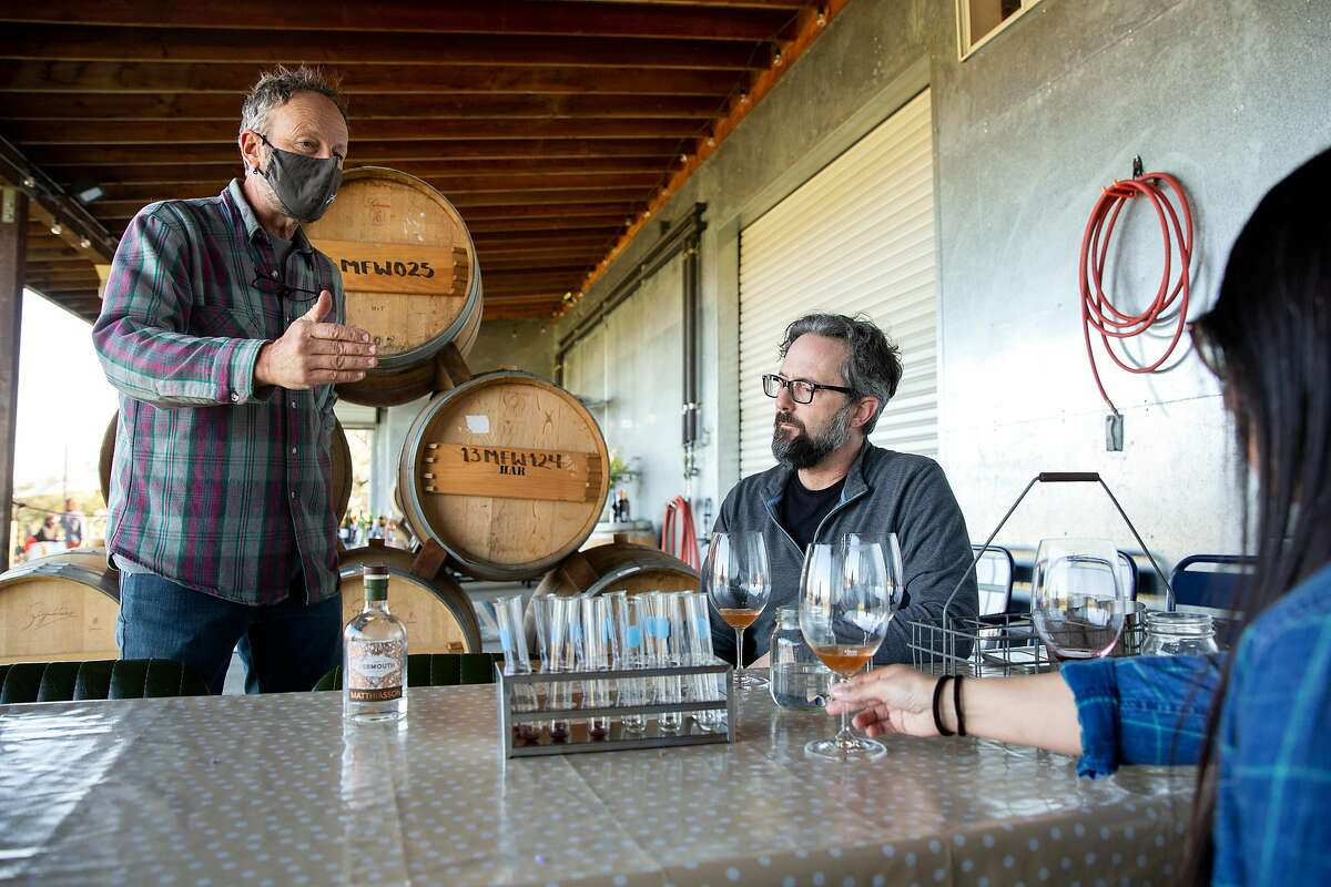 Owner Steve Matthiasson talks with guests Barry and Celia Cowan during their wine tasting at Matthiasson Winery in Napa on March 13, 2021. Napa County advanced into the state's least-restrictive coronavirus economic reopening tier Tuesday.
