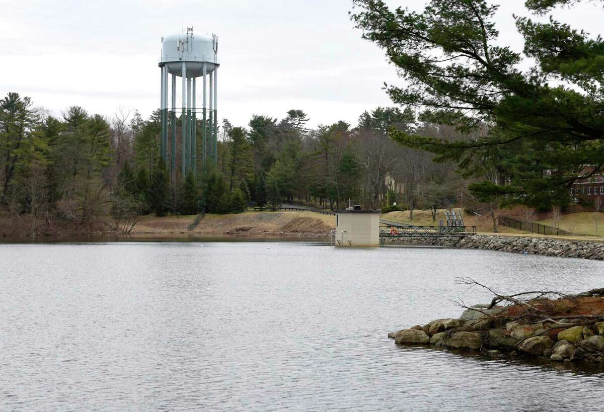The water level has returned to a safe level at Putnam Reservoir in Greenwich, Conn. Wednesday, March 24, 2021. A wet fall and snowy winter have helped the Greenwich reservoir return to a healthy level for spring, but watering restrictions will remain in place.