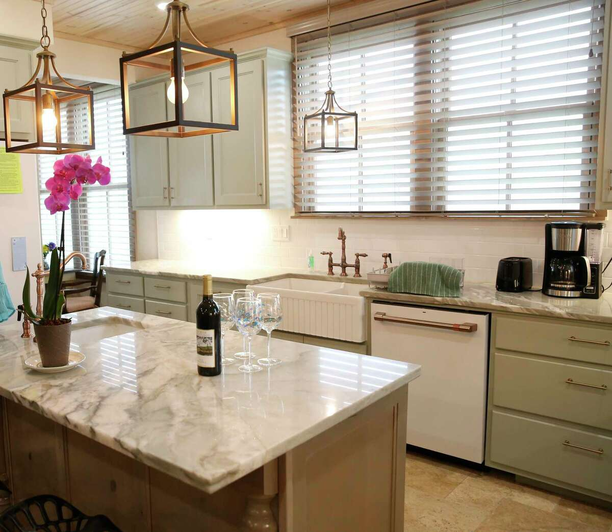 The center island and counter in the kitchen are both topped with a natural stone quartzite that has a handsome greenish veining. Green was a popular shade used in old country kitchens, according to owner Ben Culpepper.