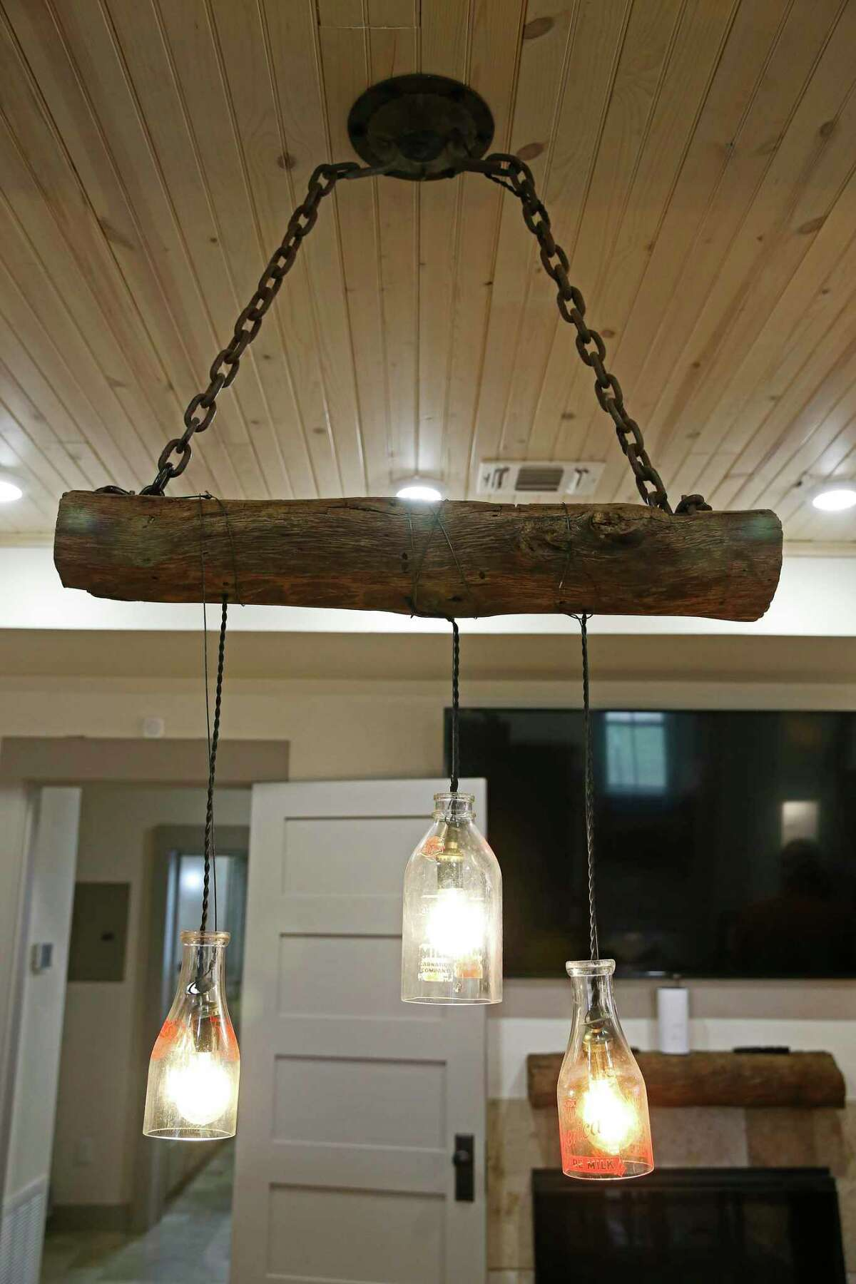 The Culpeppers repurposed many artifacts they found on the property. The chandelier over the dining room, for example, is made of three glass milk bottles cut in half and hung from a large hunk of wood. It's suspended by a thick iron chain Ben dug up in the backyard.