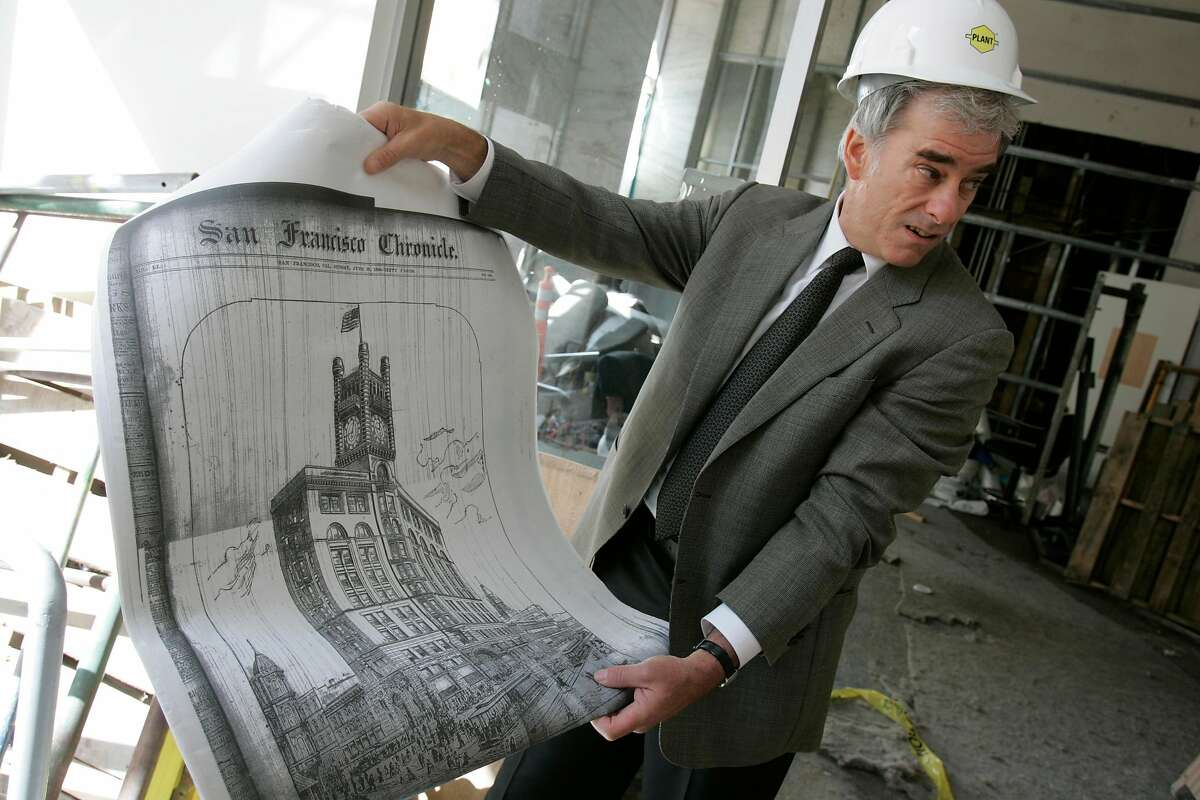 Architect Charles Bloszies shows an old drawing of the former Chronicle Building while inside the building at 690 Market St. in 2005 as it was converted into condos.