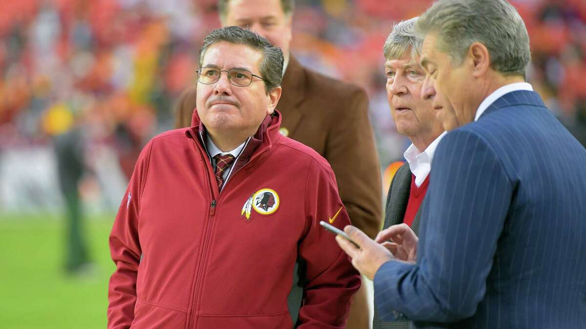 Washington Football Team majority owner Daniel Snyder, left, talks with minority owners Dwight Schar and Robert Rothman before a game.