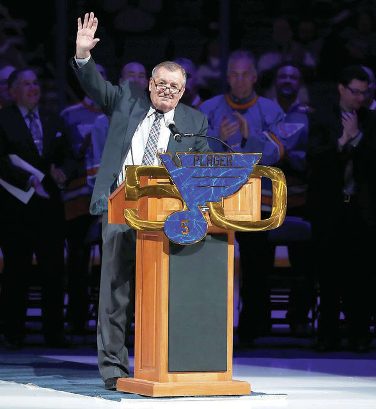 Former Blues player Bob Plager waves to fans while speaking during a ceremony to retire his number before a 2017 game between the Blues and the Toronto Maple Leafs. Plager, 78, was killed Wednesday afternoon in a car crash on Interstate 64 in St. Louis.