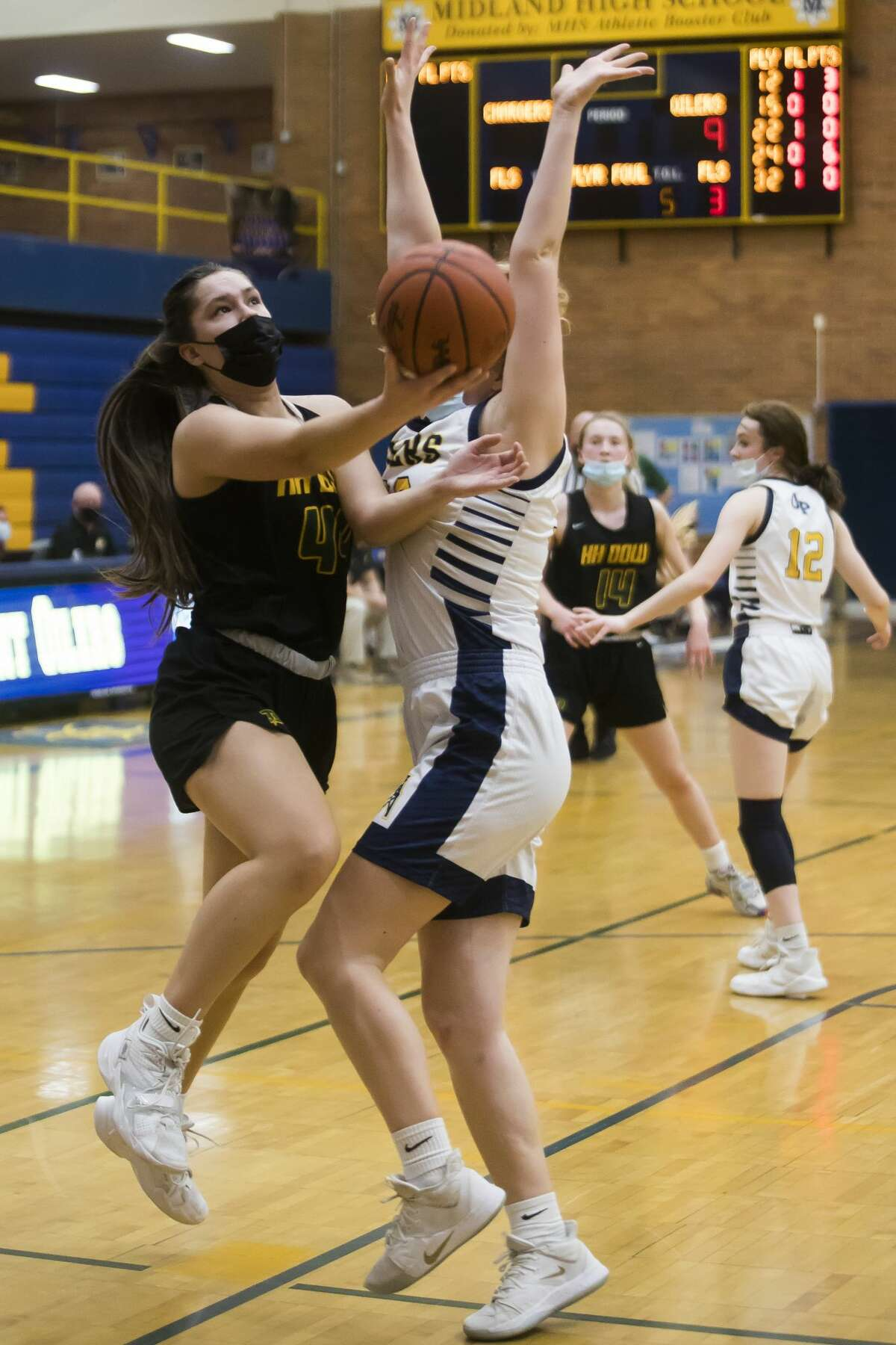 Dow's Abby Rey takes a shot during the Chargers' district semifinal against Mount Pleasant Wednesday, March 24, 2021 at Midland High School. (Katy Kildee/kkildee@mdn.net)