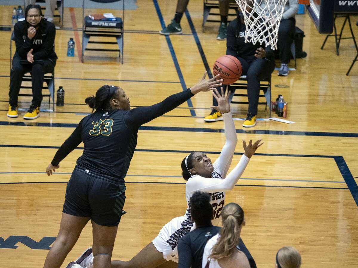 Jasmine Franklin, right, puts up a shot against Wright State center Tyler Frierson (33) during the first quarter of a college basketball game in the second round of the women's NCAA tournament at the University of Texas at San Antonio Convocation Center in San Antonio, Texas, Wednesday., March 24, 2021. (AP Photo/Michael Thomas)