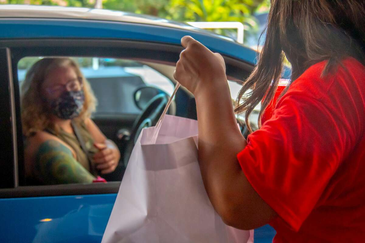 Due to the pandemic, the usual annual Salute to Nurses event changed. Houston Chronicle volunteers set up a drive-thru event to distribute winner gift bags and more at the Houston Chronicle.