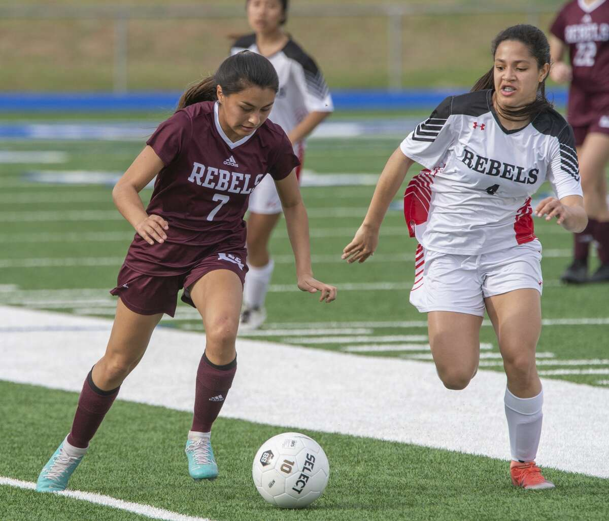 Lee's Sarah Ramos looks to control the ball as Amarillo Tascosa's Daryinet Aguilera goes after it 03/10/2020 at Grande Communications Stadium. Tim Fischer/Reporter-Telegram
