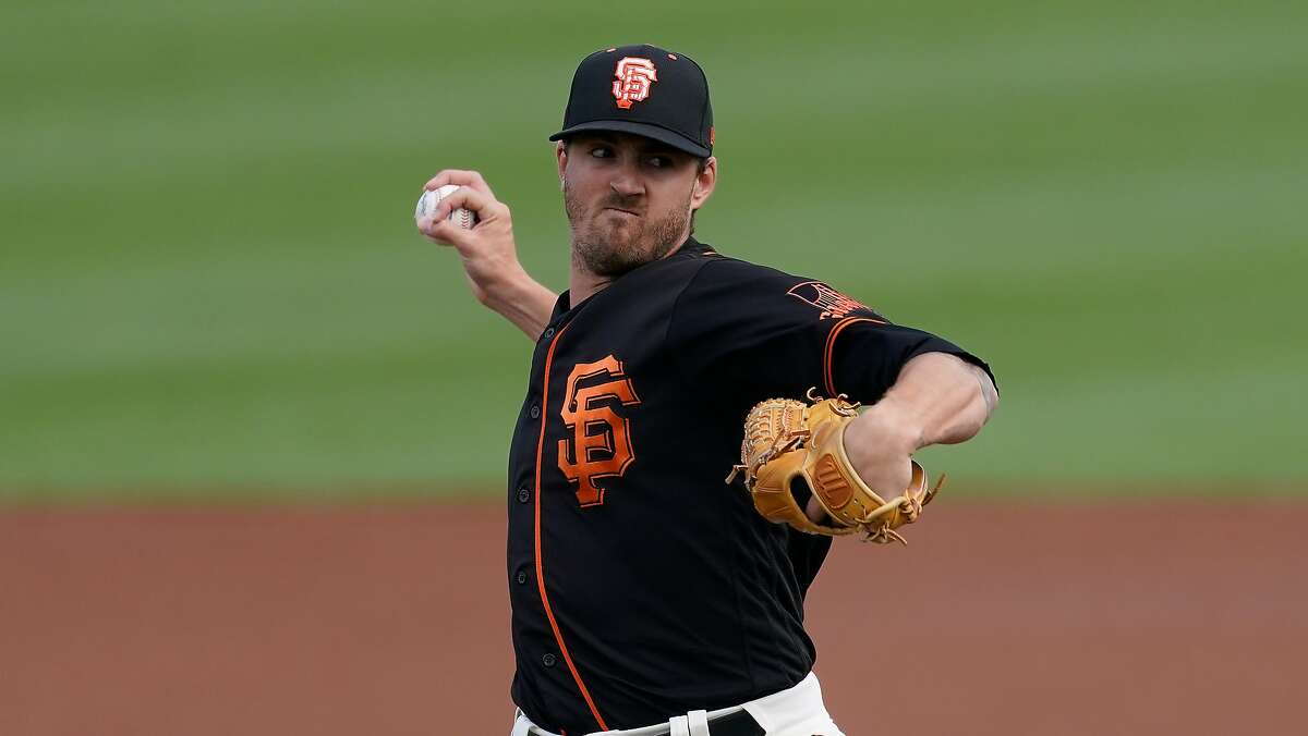 San Francisco Giants starting pitcher Kevin Gausman throws during the first inning of a spring training baseball game against the Colorado Rockies Friday, March 12, 2021, in Scottsdale, Ariz. (AP Photo/Ashley Landis)