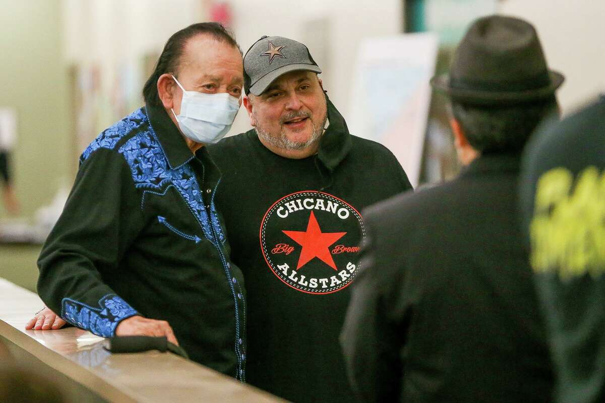 Flaco Jimenez, left, and Max Baca with Los Texmaniacs take a break after performing for the people in the waiting room receiving vaccinations at at WellMed's Elvira Cisneros Senior Community Center at 517 SW Military Drive on Wednesday, March 24, 2021.