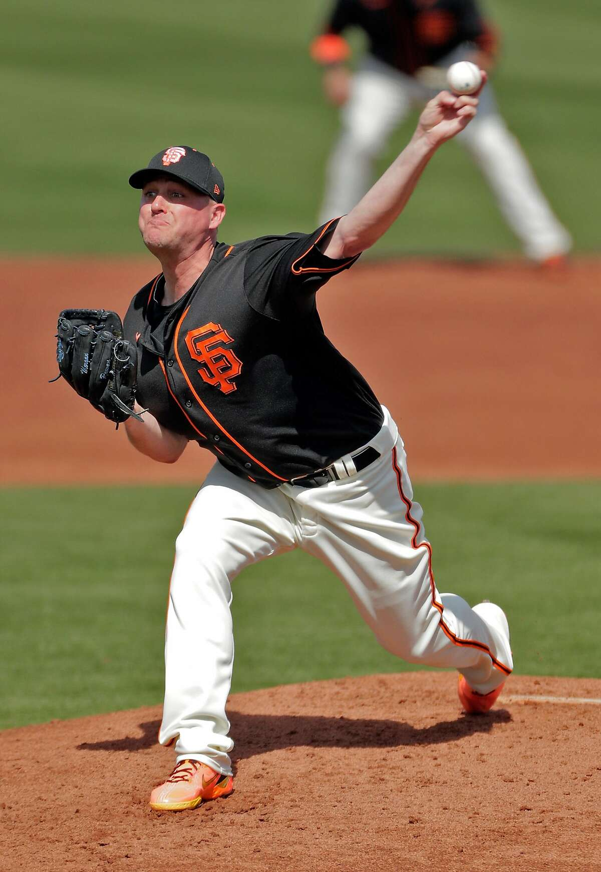 Jake McGee (17) pitches in the second inning as the San Francisco Giants played the Chicago White Sox in a spring training game at Scottsdale Stadium in Scottsdale, Ariz., on Thursday, March 4, 2021.