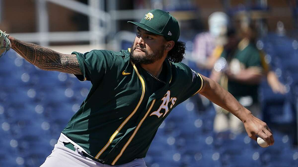 Oakland Athletics' Sean Manaea pitches in the first inning of a spring training baseball game against the San Diego Padres, Thursday, March 18, 2021, in Peoria, Ariz. (AP Photo/Sue Ogrocki)
