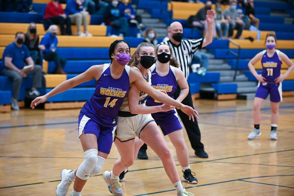 Midland's Jade Dawson gets in position during the Chemics' district semifinal game against Bay City Central Wednesday, March 24, 2021 at Midland High School. (Adam Ferman/ for the Daily News)