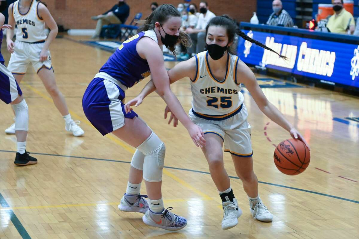 Midland's Sydnie Schafer drives to the hoop during the Chemics' district semifinal game against Bay City Central Wednesday, March 24, 2021 at Midland High School. (Adam Ferman/ for the Daily News)