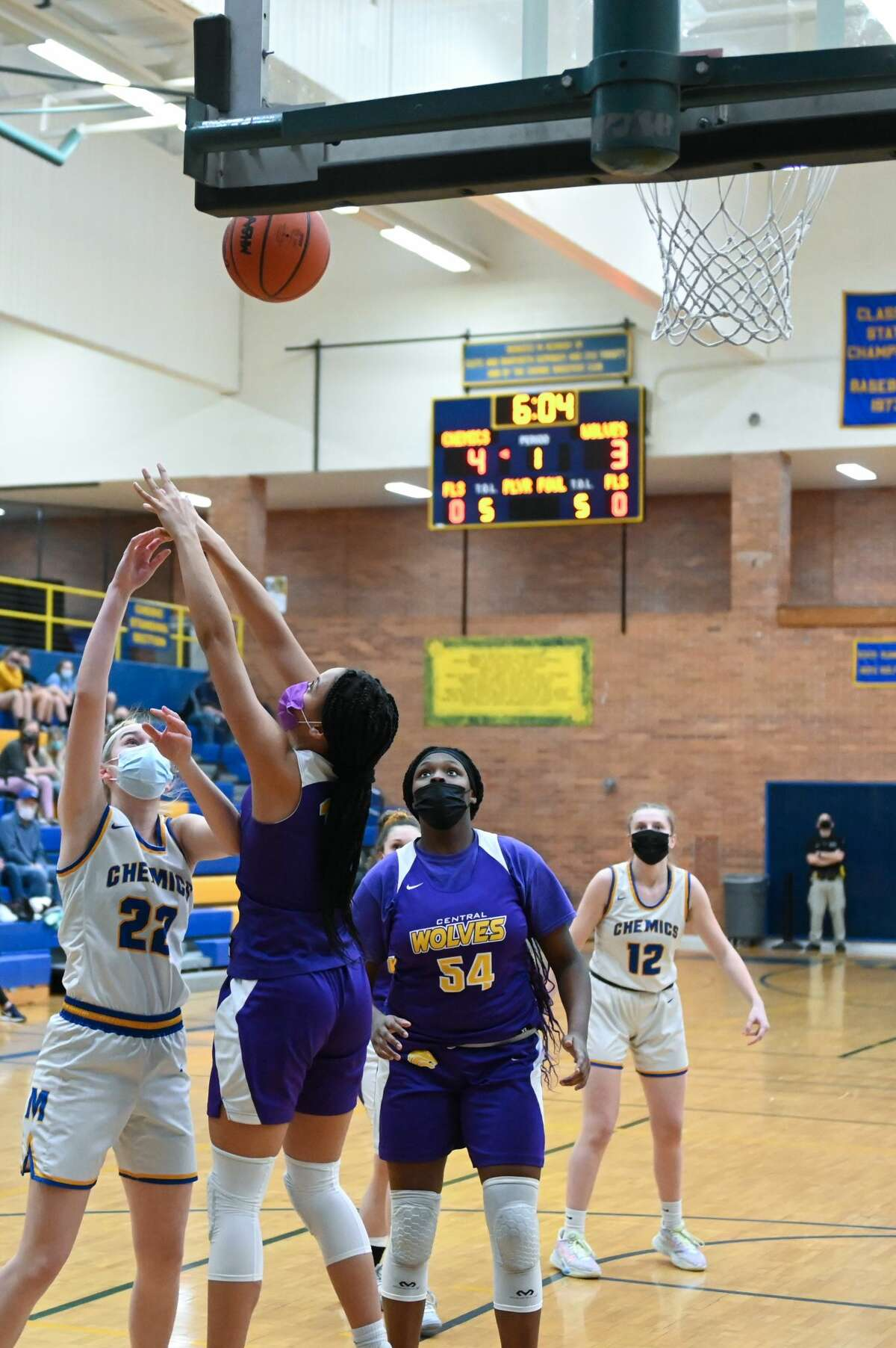 Midland's Anna Tuck puts up a shot during the Chemics' district semifinal game against Bay City Central Wednesday, March 24, 2021 at Midland High School. (Adam Ferman/ for the Daily News)