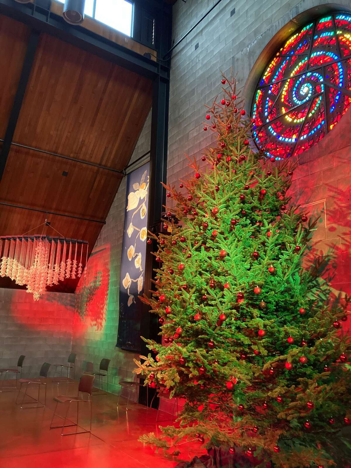 Every year, the Christ Sun of Justice Chapel & Cultural Center buys a huge tree and a smaller students' Christmas tree. The big tree sits near the oculus stained glass window designed by liturgical artist Ade Bethune.