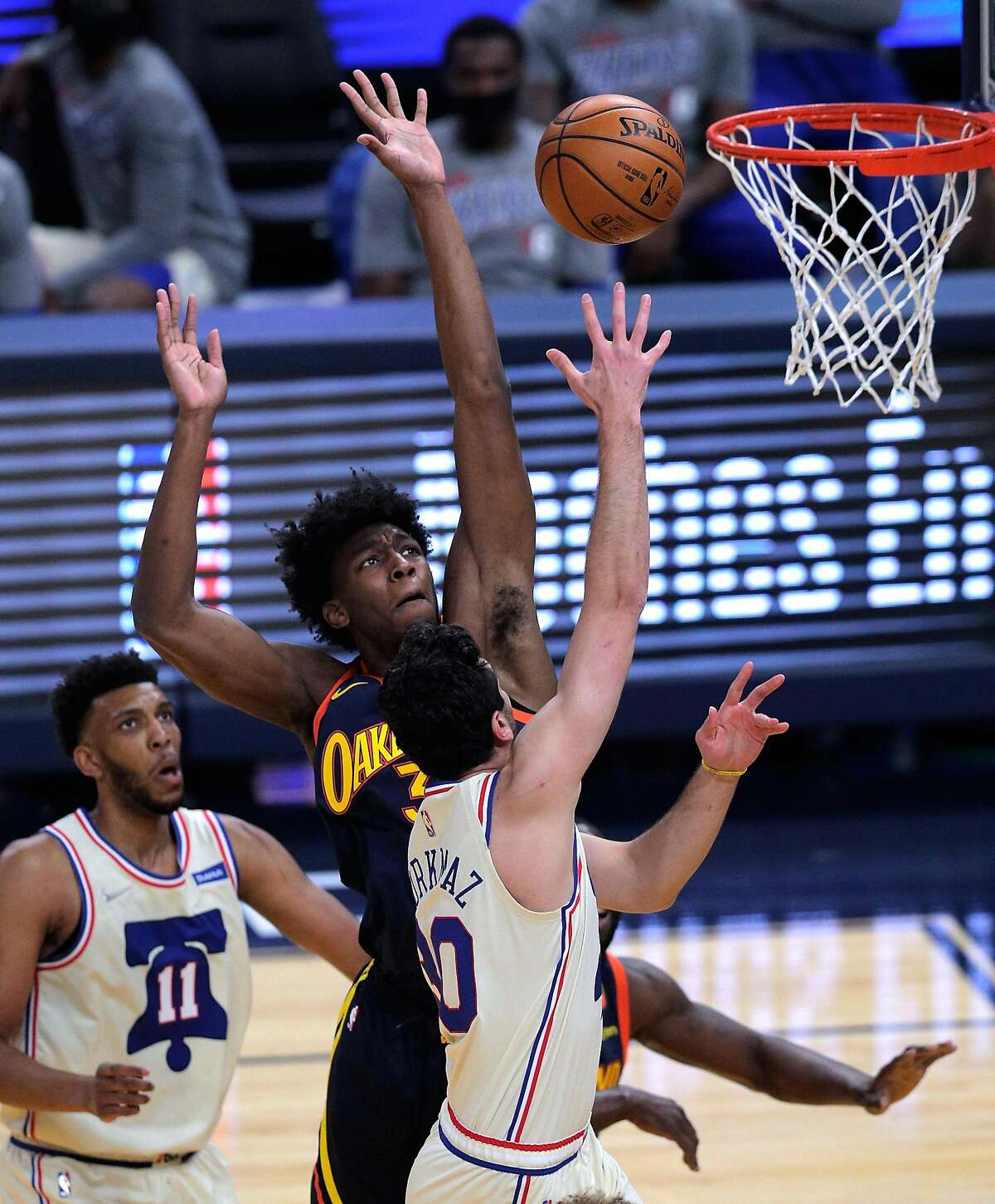 James Wiseman (33) goes up to defend against a shot by Furkan Korkmaz (30) in the first half as the Golden State Warriors played the Philadelphia 76ers at Chase Center in San Francisco, Calif., on Tuesday, March 23, 2021.
