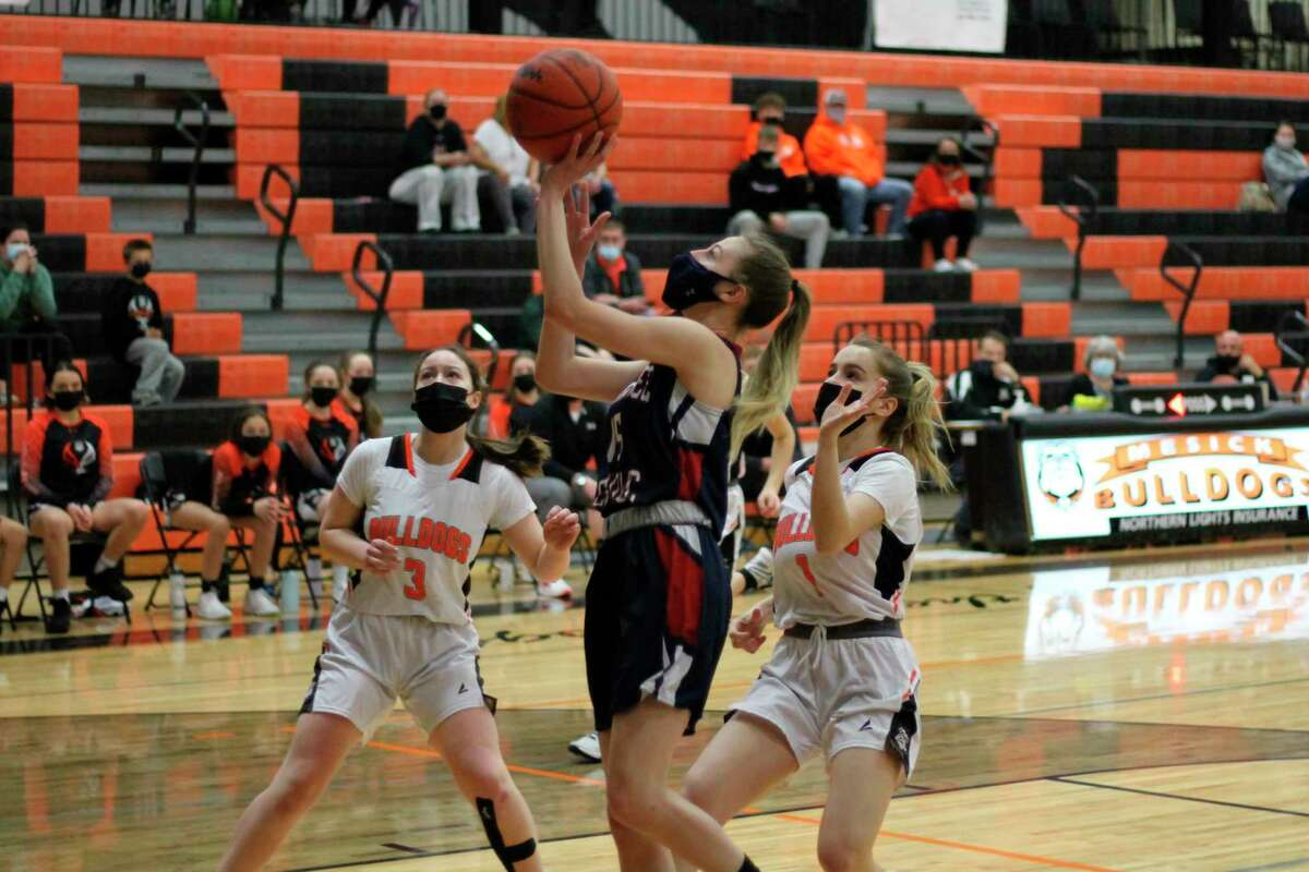 Manistee Catholic's Ashley VanAelst drives for a layup during the first half of Wednesday's district semifinal loss to Mesick. (Robert Myers/News Advocate)