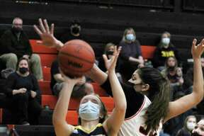 Manistee's Jayna Edmondson goes up for a shot against Ludington in Wednesday's Division 2 district semifinal in Kingsley. (Dylan Savela/News Advocate)