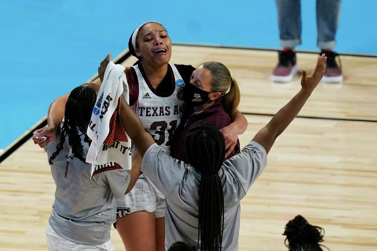 Texas A&M forward N'dea Jones (31) celebrates with teammates after a college basketball game against Iowa State in the second round of the women's NCAA tournament at the Alamodome in San Antonio, Wednesday, March 24, 2021. Texas A&M won 84-82 in overtime. (AP Photo/Eric Gay)