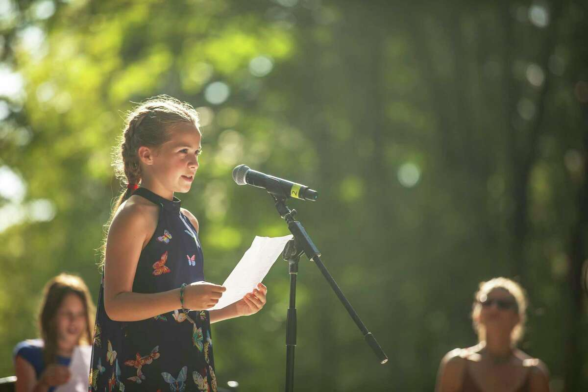 A top selected young writer performs her piece at 2019's Five Senses Festival in Washington.