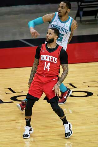 Houston Rockets guard D.J. Augustin (14) makes a three point shot during the third quarter of an NBA game between the Houston Rockets and Charlotte Hornets on Wednesday, March 24, 2021, at Toyota Center in Houston. Photo: Mark Mulligan, Staff Photographer / © 2021 Mark Mulligan / Houston Chronicle