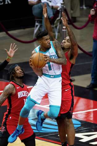 Charlotte Hornets guard Malik Monk (1) drives around Houston Rockets forward Sterling Brown (0) during the third quarter of an NBA game between the Houston Rockets and Charlotte Hornets on Wednesday, March 24, 2021, at Toyota Center in Houston. Photo: Mark Mulligan, Staff Photographer / © 2021 Mark Mulligan / Houston Chronicle