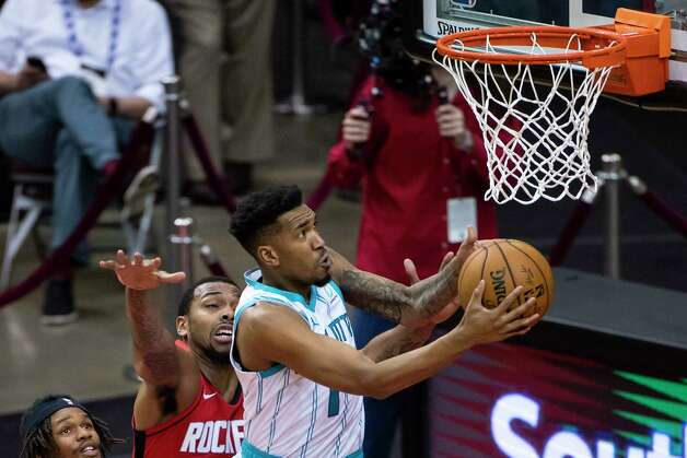 Charlotte Hornets guard Malik Monk (1) shoots around Houston Rockets forward Sterling Brown (0) during the third quarter of an NBA game between the Houston Rockets and Charlotte Hornets on Wednesday, March 24, 2021, at Toyota Center in Houston. Photo: Mark Mulligan, Staff Photographer / © 2021 Mark Mulligan / Houston Chronicle
