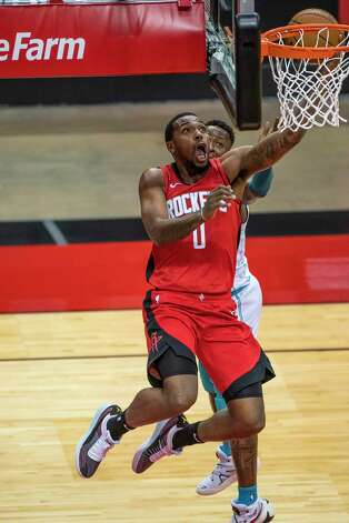 Houston Rockets forward Sterling Brown (0) shoots during the third quarter of an NBA game between the Houston Rockets and Charlotte Hornets on Wednesday, March 24, 2021, at Toyota Center in Houston. Photo: Mark Mulligan, Staff Photographer / © 2021 Mark Mulligan / Houston Chronicle