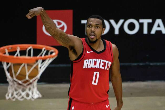 Houston Rockets forward Sterling Brown (0) makes a three point shot during the third quarter of an NBA game between the Houston Rockets and Charlotte Hornets on Wednesday, March 24, 2021, at Toyota Center in Houston. Photo: Mark Mulligan, Staff Photographer / © 2021 Mark Mulligan / Houston Chronicle