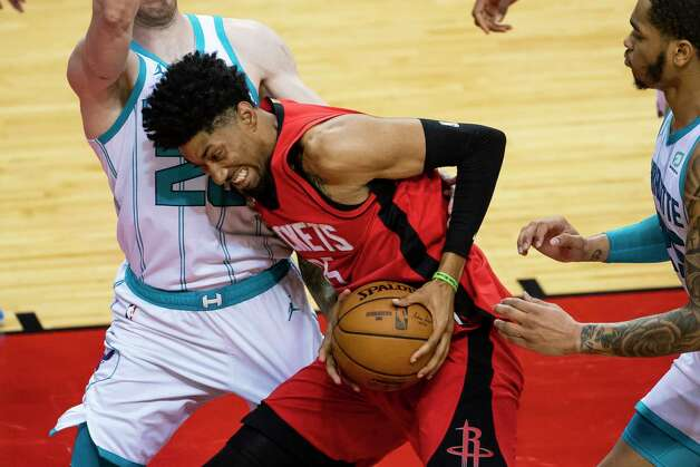 Houston Rockets center Christian Wood (35) drives into Charlotte Hornets forward Gordon Hayward (20) during the third quarter of an NBA game between the Houston Rockets and Charlotte Hornets on Wednesday, March 24, 2021, at Toyota Center in Houston. Photo: Mark Mulligan, Staff Photographer / © 2021 Mark Mulligan / Houston Chronicle