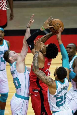 Houston Rockets center Christian Wood (35) shoots over Charlotte Hornets forward Gordon Hayward (20) during the third quarter of an NBA game between the Houston Rockets and Charlotte Hornets on Wednesday, March 24, 2021, at Toyota Center in Houston. Photo: Mark Mulligan, Staff Photographer / © 2021 Mark Mulligan / Houston Chronicle