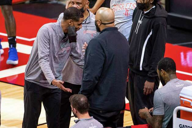 Rockets head coach Stephen Silas and Houston Rockets guard John Wall (1) have an animated discussion on the sideline during the third quarter of an NBA game between the Houston Rockets and Charlotte Hornets on Wednesday, March 24, 2021, at Toyota Center in Houston. Photo: Mark Mulligan, Staff Photographer / © 2021 Mark Mulligan / Houston Chronicle