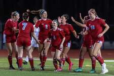 The team congratulates Lauren Locicero (2) on scoring a goal in the second half as Lumberton girls soccer dominated the Lady Bucs of East Chambers in their match on Friday, February 7, 2020. Fran Ruchalski/The Enterprise